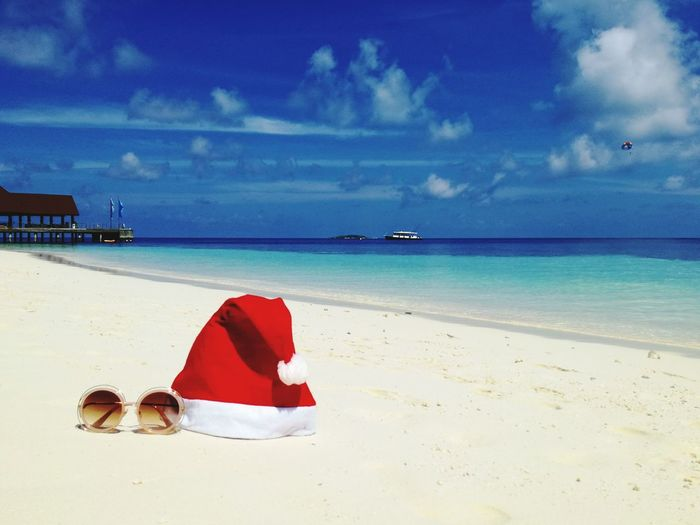 Christmas in paradise! Beach Sea Sand Red Island Horizon Over Water Sun Vacations Tropical Climate Cloud - Sky Sky Summer Water Travel Destinations Idyllic Landscape Nature Travel Tranquility Blue Christmastime Christmas Decoration Christmas In Paradise Maledives Malediven