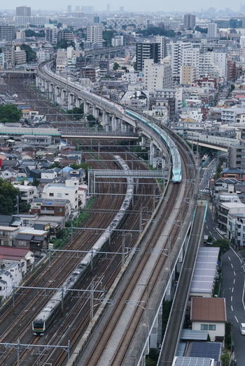 High angle view of trains on railroad tracks amidst buildings in city