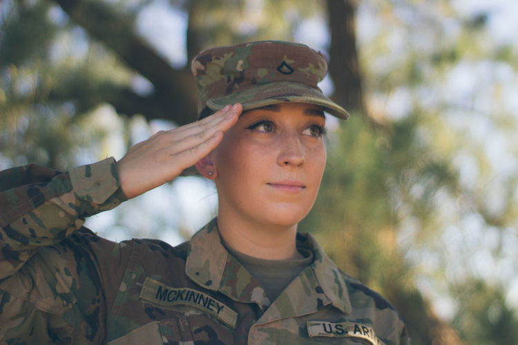 Close-up of soldier saluting outdoors