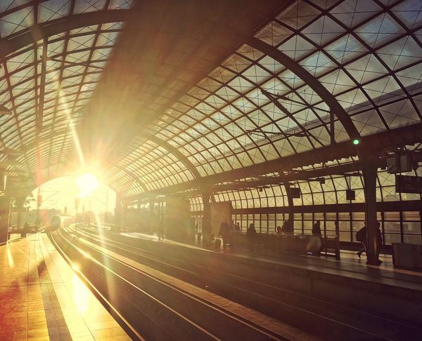 Morning travel. ıce Deutsche Bahn Sunrise Sunlight Morning Light Transportation Rail Transportation Railroad Station Platform Public Transportation Railroad Station Train - Vehicle Colour Your Horizn Lens Flare Mode Of Transport Railroad Track Sunlight Travel Architecture Built Structure Day City Train Station Station