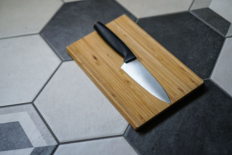 High angle view of cutting board on table