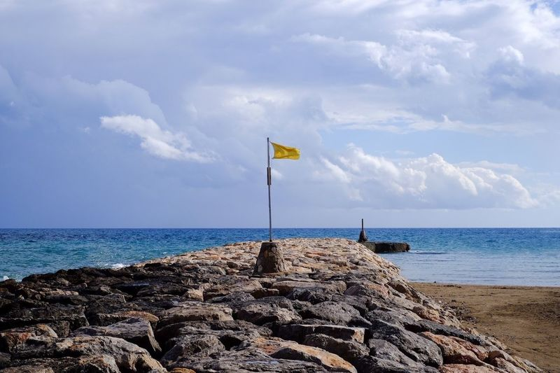 Sea And Sky Sea Seascape Yellow Flag Sky And Clouds Clouds And Sky Mediterranean  España Sitges SPAIN