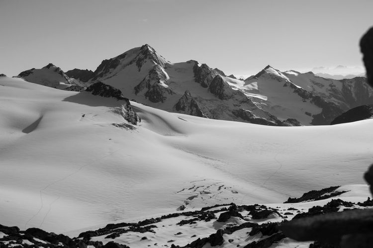 Hiking Starting A Trip Adventure Beauty In Nature Blackandwhite Clear Sky Cold Temperature Day Glacier Landscape Mountain Mountain Range Mountains Nature No People Outdoors Physical Geography Scenics Sky Slope Snow Snowcapped Mountain Tranquil Scene Tranquility Winter