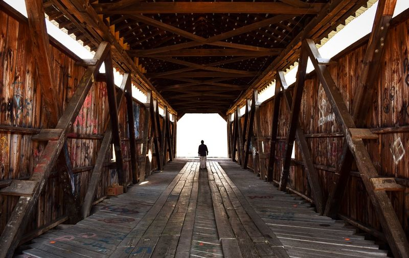 Following my boyfriend through the covered bridge and out into the daylightThe Following Covered Bridge Symmetry Pennsylvania