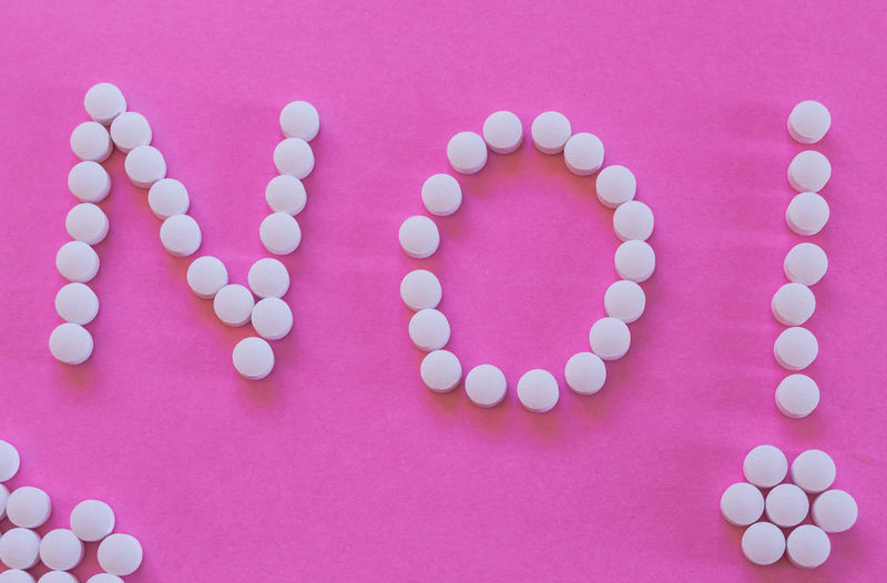 """Word """"NO"""" and an exclamation made with white pills isolated on pink background. Concept of prohibition or drug addiction treatment. Drug Drugstore Exclamation Medicine Negative Pharmacy Pills Pink Tablet Word Addiction Amphetamine Background Chemistry Close-up Colorful Concept Health Indoors  No Pastille Pastilles Refuse Still Life Temptation"""