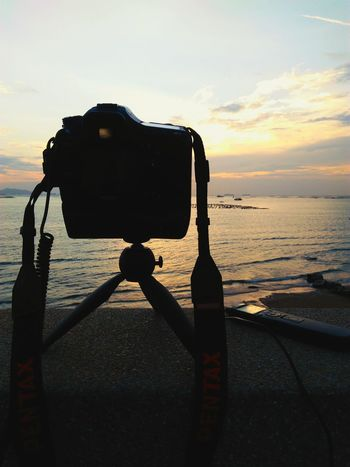 Pentax digital camera on mini tripod and remote with sunset sky at sea background Pentax Camera Digital Camera Photography Tripod Pixi Sunset Sea Scenics Remote Time Lapse Hobby Time Photo DSLR Photography DSLR Thailand Si Racha