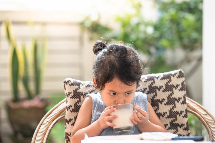 Portrait of a woman drinking water