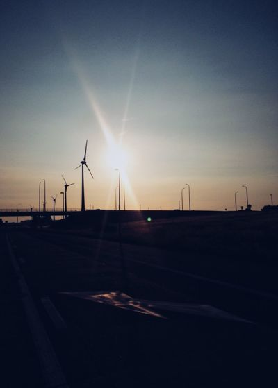 Alternative Energy Fuel And Power Generation Environmental Conservation Wind Turbine Sunset Wind Power Renewable Energy Sun No People Sky Sunlight Windmill Industrial Windmill Road Outdoors Transportation Nature Day Beauty In Nature Vapor Trail Holland Holiday