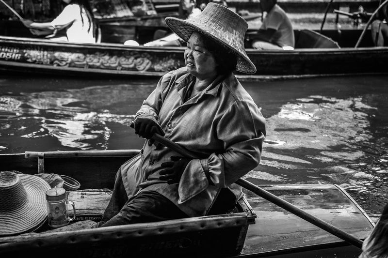 Floating market Bangkok Asian Style Conical Hat Black And White Casual Clothing Day Floating Market Floating Market Dumnoen Saduak Floating On Water Full Length Lifestyles Nautical Vessel One Person Outdoors People Real People Sitting Transportation Women Around The World Black And White Friday