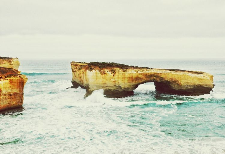 Rock formation in sea against sky at port campbell