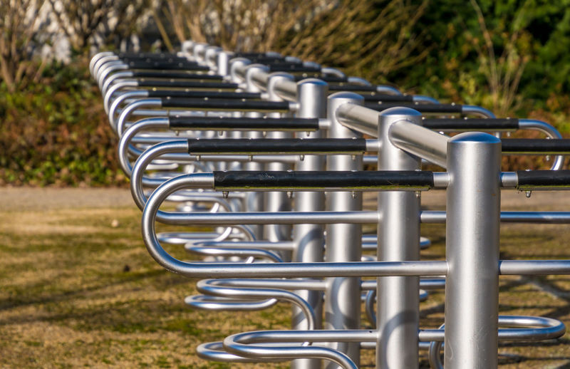 In A Row Bicycle Bicycle Rack Childhood Close-up Day Focus On Foreground In A Row Metal Metallic Minimalism Minimalistic Nature No People Outdoor Play Equipment Outdoors Park - Man Made Space Playground Rack Technology