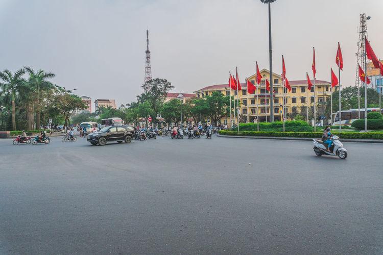People walking on road against buildings