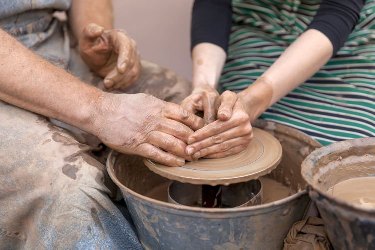 Hands working on pottery wheel Art And Craft Art is Everywhere Art, Drawing, Creativity Hands Mold Wheel Art Art And Craft Ceramics Clay Craft Creativity Expertise Hand Handicraft Handmade Human Body Part Human Hand Jar Mud Occupation Pottery Sculptor Skill  Working