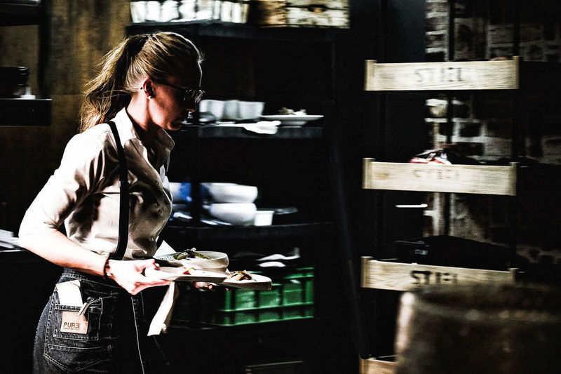 One Person One Woman Only Indoors  Looking Down Holding Standing Real People Working Restaurant Stiel Tasting Foods Tasting Wine Restaurant Food And Drink Foodlover Foodporn Ready-to-eat Plate Food Movement And Stilness Lights & Shadows
