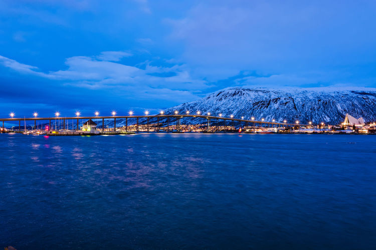 Afternoon during the blue polar night Architecture Arctic Arctic Cathedral Arcticcircle Beauty In Nature Bridge Cloud - Sky Ishavskatedralen Lights Mountain Norway Polar Night Scandinavia Sky Travel Long Exposure Tromsø Bridge Twilight Water Landscapes Landscape_Collection Travel Photography Color Palette Overnight Success