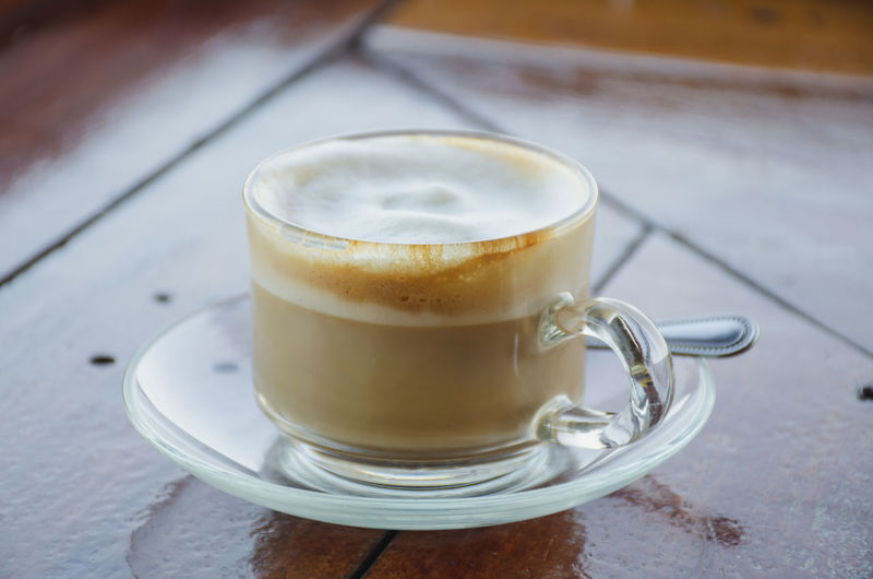 Coffee cup of hot with on wooden floor place for message.