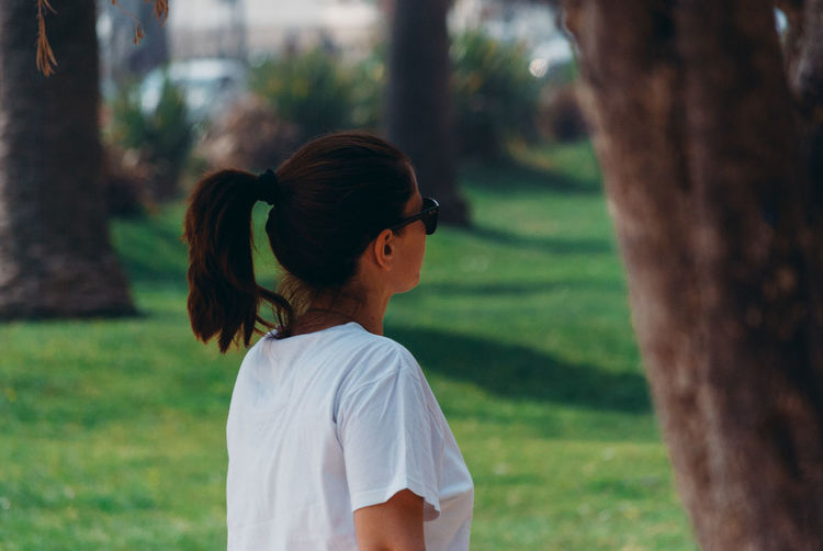 Rear view of woman in park