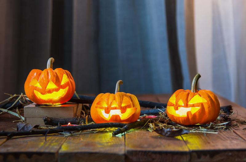 Orange pumpkins on table during autumn