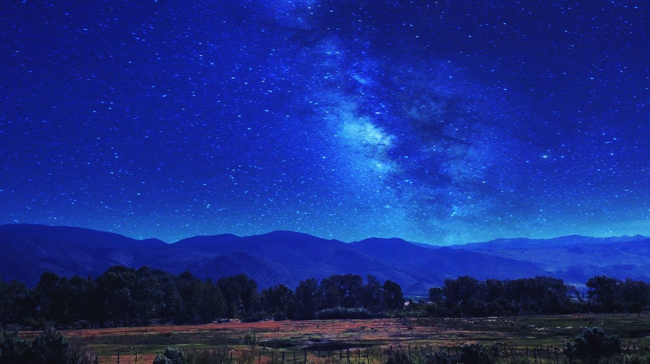 mountain, star - space, beauty in nature, tranquility, nature, tranquil scene, blue, no people, night, scenics, sky, astronomy, outdoors, galaxy, starry, space