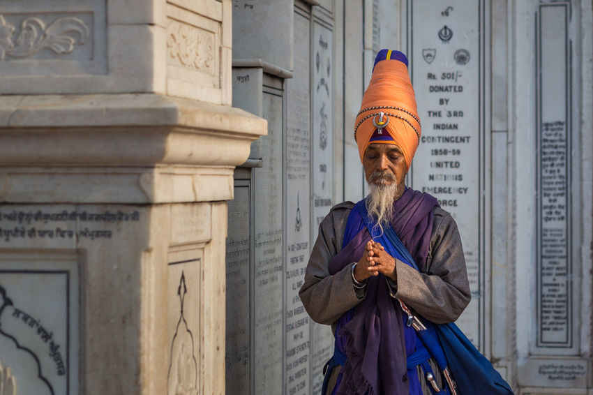 Amritsar Barefoot Colorful Golden Golden Temple Guru Holy India One Man Only One Person Praying Religion Senior Adult Sikh Sikh Temple Sikhism Standing Temple Traditional Traditional Clothing Turban Worship