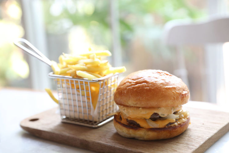Beef Burger Food Food And Drink Unhealthy Eating Fast Food Freshness Ready-to-eat Table Burger Sandwich Close-up Bread Focus On Foreground Potato Prepared Potato Still Life French Fries Indoors  Fried Hamburger Meal Take Out Food Temptation Snack Breakfast