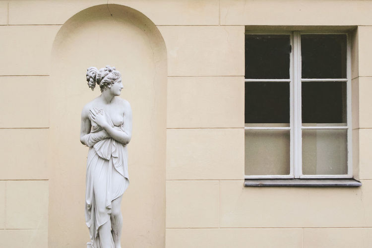 Statue against building