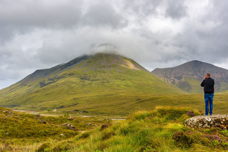 Lost In The Landscape Scotland Adult Adults Only Beauty In Nature Cloud - Sky Day Hiking Landscape Leisure Activity Lifestyles Men Mountain Mountain Range Nature One Person Outdoors Physical Geography Real People Rear View Scenics Sky Standing Tranquility Travel Destinations Volcanic Landscape Volcano