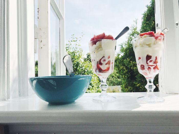 Close-up of vanilla ice cream on window sill