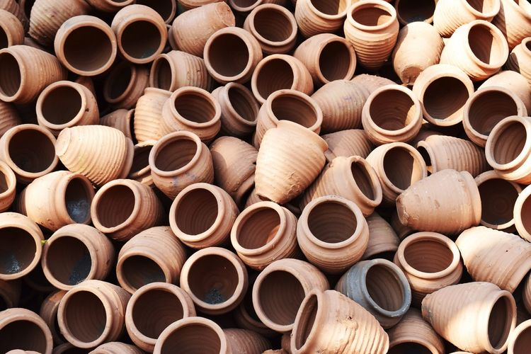 View of Roadside displayed Clay Utensils for Indian Kitchen Abundance Close-up Day Display Industry Large Group Of Objects No People Outdoors Roadside Selling Skill  Stack Terracotta