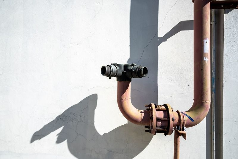 Man photographing against wall