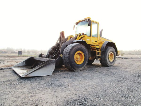 Heavy Duty Machinery Heavy Machinery EyeEm Selects Dump Truck Construction Equipment Quarry Vehicle Land Vehicle Road Construction Industrial Equipment Construction Material Bulldozer Earth Mover Tractor