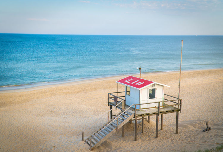 Horizon Sea Water Horizon Over Water Sky Beach Land Nature Scenics - Nature No People Sign Day Architecture Beauty In Nature Blue Tranquil Scene Tranquility Hut Sand Outdoors