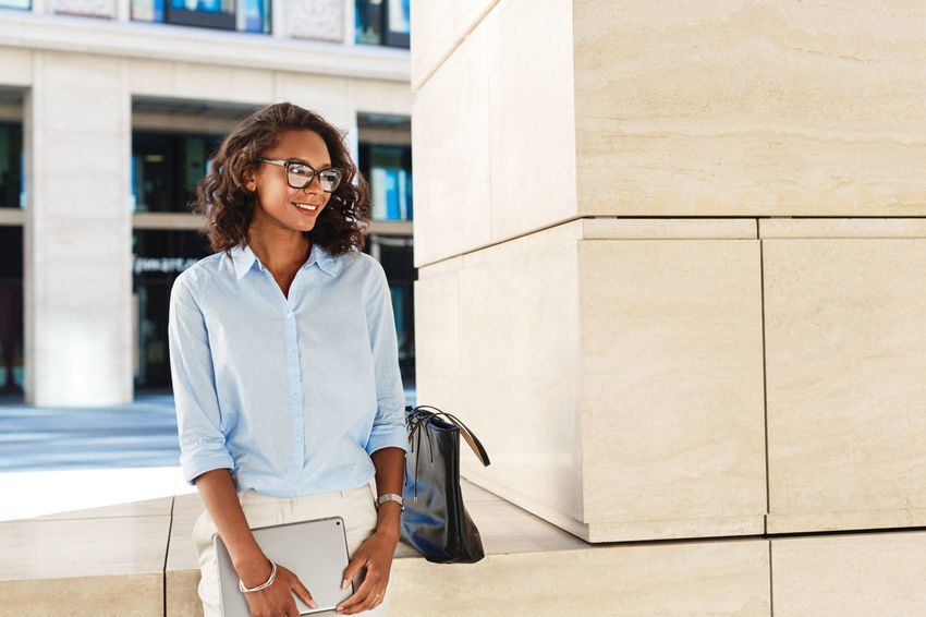 Business Person Women One Person Hairstyle Front View Looking At Camera Modern Looking Technology African American Standing Outdoors Females Talking Relaxing Real People Entrepreneur Eyeglasses  Holding Building