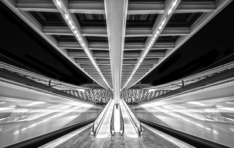 Long exposure bnw night capture on train platform with 2 passing trains Illuminated Architecture Transportation The Way Forward Diminishing Perspective Built Structure Modern Direction Motion No People Futuristic Technology Lighting Equipment Mode Of Transportation Speed Travel Long Exposure Bnw Blackandwhite Train Trains Platform Train Platform Stationary
