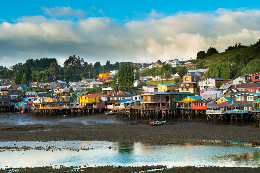 Traditional stilt houses know as palafitos in the city of Castro at Chiloe Island in Southern Chile Chile Chilean  Chilöe Chiloé, Chile City Cityscape Isla De Chiloe Lake District Latin America Palafitos Skyline Architecture Building Castro Chiloe Chile Chiloe Island Chilöe Latin American Pile-dwelling Region De Los Lagos Stilts Houses Town Traditional Village Waterfront