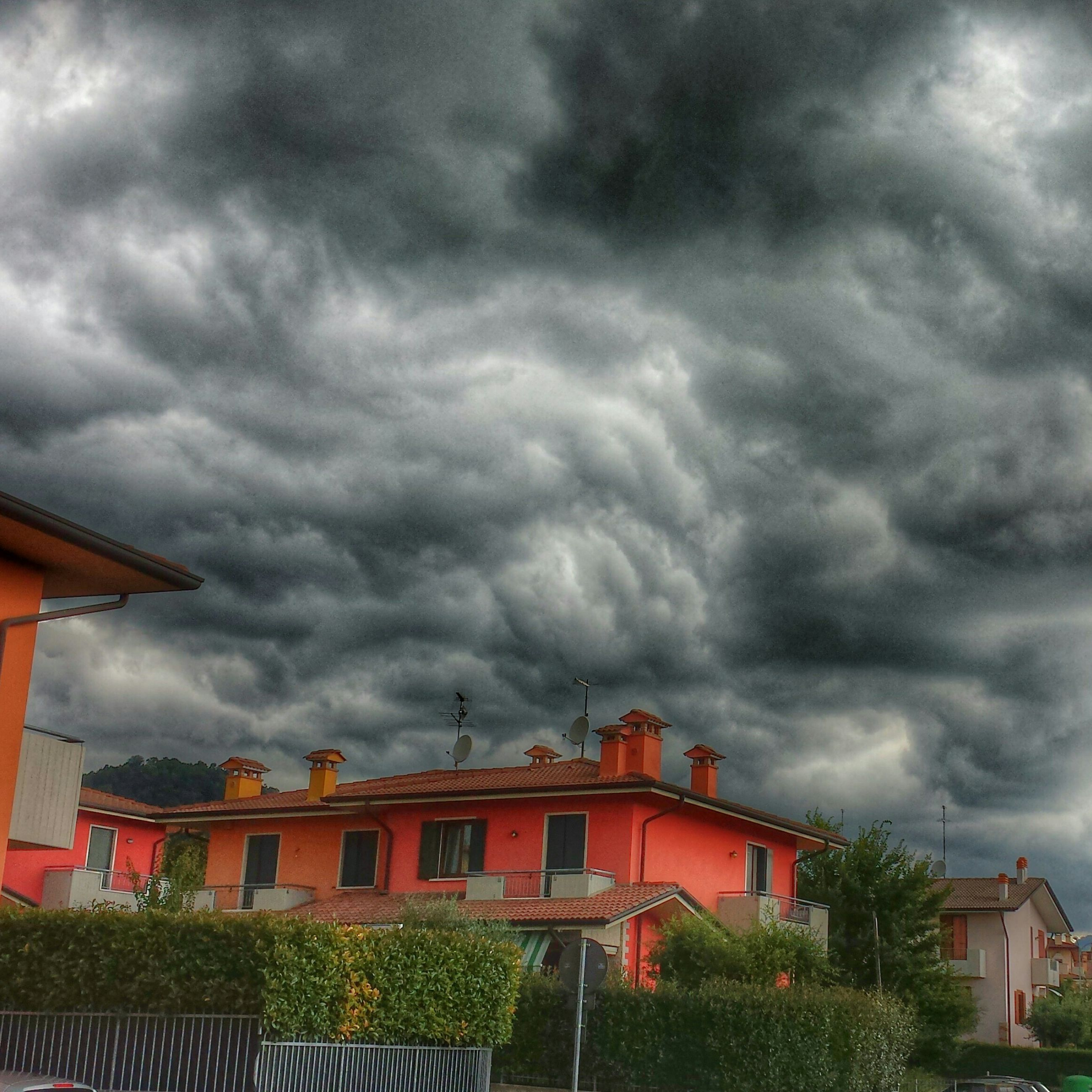 architecture, cloud - sky, cloudy, building exterior, sky, built structure, weather, storm cloud, overcast, cloud, house, low angle view, residential structure, dramatic sky, residential building, cloudscape, roof, outdoors, atmospheric mood, nature