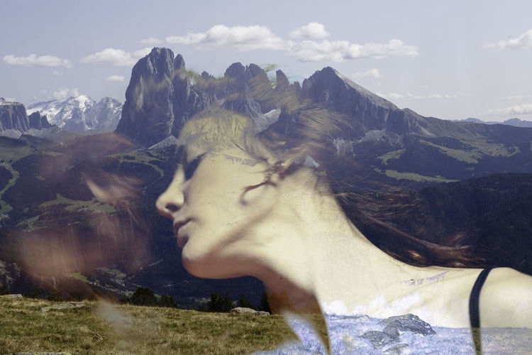 Double exposure of woman and mountains