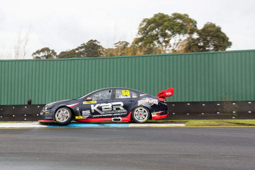 MELBOURNE/AUSTRALIA - SEPTEMBER 17, 2016: Supercars Race 20 - Sandown 500 'Retro' Endurance race at Sandown raceway. Car Fast Motor Racing Motor Sport Race Race Track Speed Supercar