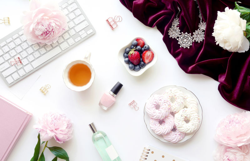 Beauty products and food on white table