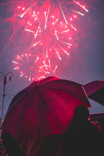 Fireworks under the rain Umbrella Protection Sky Security Red Nature Outdoors Cloud - Sky Low Angle View Rain Wet No People Pink Color Safety Beauty In Nature Parasol Day Water Fireworks Catania Sicily Rain