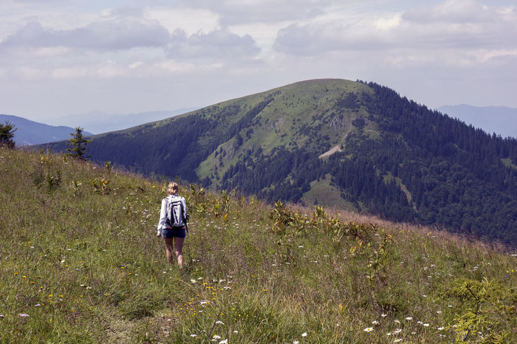 Velka Fatra Beauty In Nature Cloud - Sky Day Environment Grass Landscape Leisure Activity Lifestyles Mountain Mountain Range Nature Non-urban Scene One Person Outdoors Plant Real People Rear View Scenics - Nature Sky Tranquil Scene Tranquility Walking