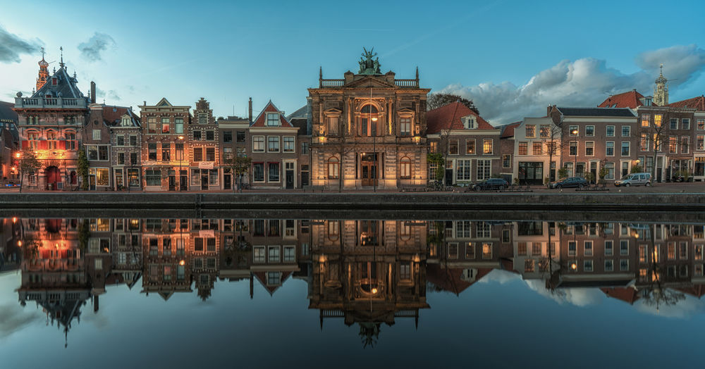 Haarlem cityscape including the oldest museum of The Netherlands, the Teylers museum Blue Hour City Cityscape Haarlem Netherlands Teylers Museum The Netherlands Canal Holland Reflections River Tourist Destination Town Travel Destinations Urban Landscape TOWNSCAPE Housing Settlement Waterfront Standing Water Place Of Worship Calm Place Reflecting Pool Symmetry The Architect - 2018 EyeEm Awards