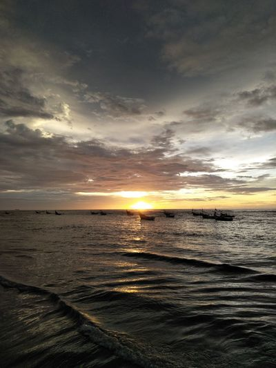 sunset sea beach horizon over water beauty in Nature water cloud - sky Dramatic sky outdoors Tranquility travel dest Sunset Sea Beach Horizon Over Water Beauty In Nature Water Cloud - Sky Dramatic Sky Outdoors Tranquility Travel Destinations Tes Nature_perfection Landscape Long Beach Island Bengkulu Indonesia Sunlight Sun Dramatic Sky Fishing No People Tranquil Scene Scenics Nature Horizon Idyllic Sky
