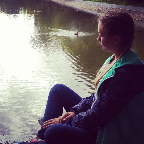 Woman sitting in lake
