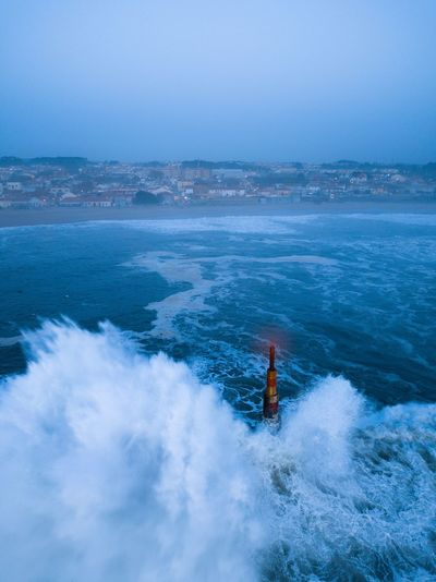 Bluehour in Aguda's blue sea Beach Blue Hour Atlantic Ocean Aguda Beach Ocean Portugal Porto Bluesea Waves Drone  Dronephotography Drones Drone Dji Drone Moments Drone Photography Drone View Winter Water Sea Blue Beauty In Nature Nature Sky Scenics - Nature Day Wave Surfing Outdoors Aquatic Sport Power In Nature Motion