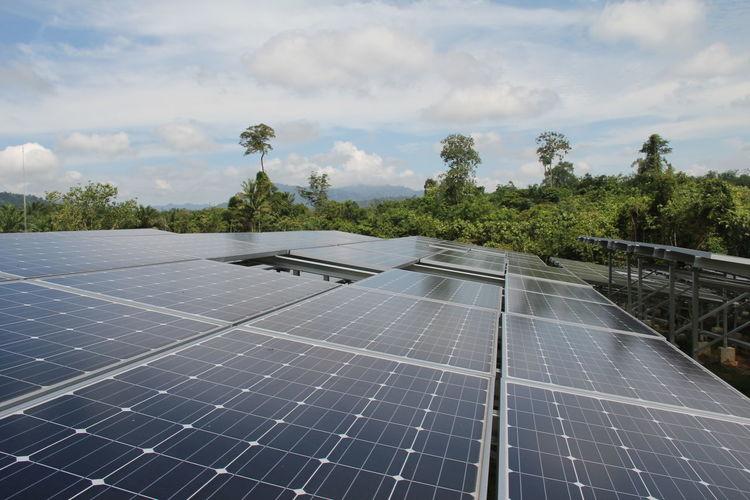 Solar panels against cloudy sky
