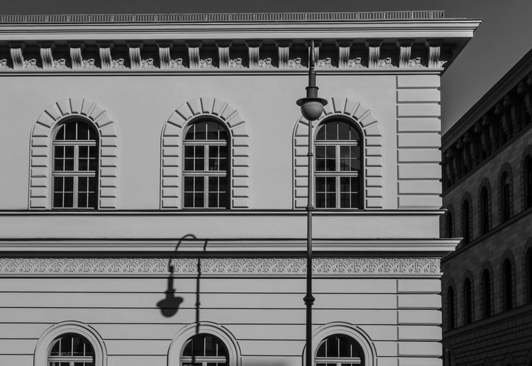 Arch Arched Architecture B&w Black And White Building Exterior Built Structure City Life Day Exterior Façade High Section Historic Light And Shadow Low Angle View No People Outdoors Residential Building Streetlamp Streetlight Window