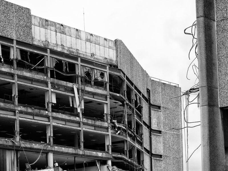 Architecture Building Built Structure Cable City Cloud - Sky Construction Day Demolition Demolition Site Demolition Zone Development Engineering Exterior Low Angle View Nature No People Outdoors Overcast Scaffolding Sky