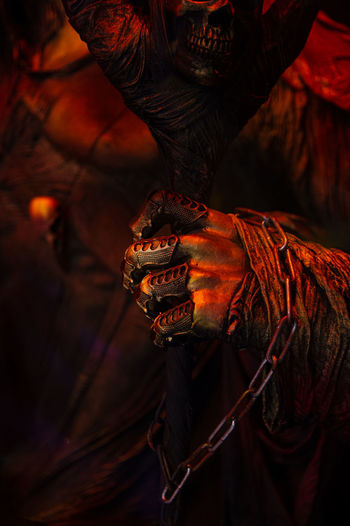Halloween spooky  fearfull horrible terrible warlock's hand in rags in bloody red orange gold colors