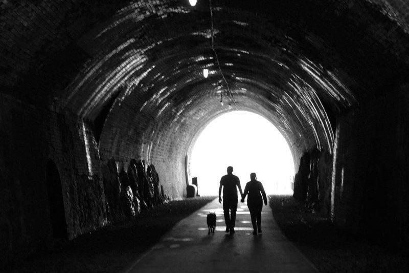 Light at the end of the tunnel.... Tunnel Silhouette Two People Photography Is My Escape From Reality! Check This Out From My Point Of View For Anyone Whos Interested Derbyshire Peak District  Monsal Trail Mental Health Awareness Mentalhealth  Blackandwhite